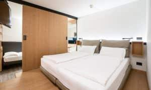 Camera da letto appartamento superior 5 Ambiez di Residence Hotels