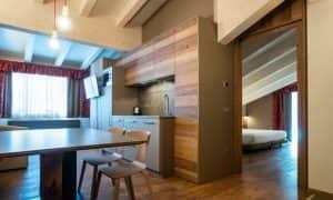 soggiorno con angolo cottura a vista appartamento superior